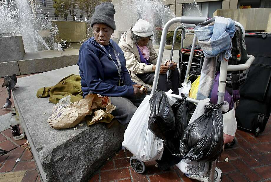 Karen, a homeless person, (left) sits with a friend near the fountain at U.N. Plaza in San Francisco, Calif. Photo: Brant Ward, The Chronicle