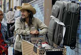 David, a homeless person, (right) talked with a friend while waiting in a line to eat at Glide Memorial Church in San Francisco, Calif. A federal appeals court ruled Wednesday September 5, 2012 that municipalities must allow homeless persons the chance to reclaim personal items taken by police.