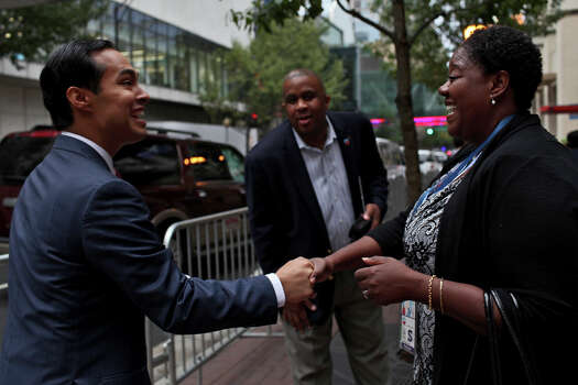 Mayor Julian Castro, left, receives congratulations from people passing on the street the morning after his keynote speech during the Democratic National Convention in Charlotte, NC on Wednesday, Sept. 5, 2012. Photo: Lisa Krantz, San Antonio Express-News / San Antonio Express-News