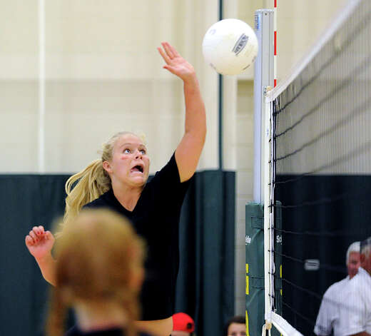 Greenwich Academy's Grace Evans hits prior to vollyball scrimmage against Holy Child at Greenwich Academy, Wednesday, Sept. 5, 2012. Evans is a co-captain of the team. Photo: Bob Luckey / Greenwich Time