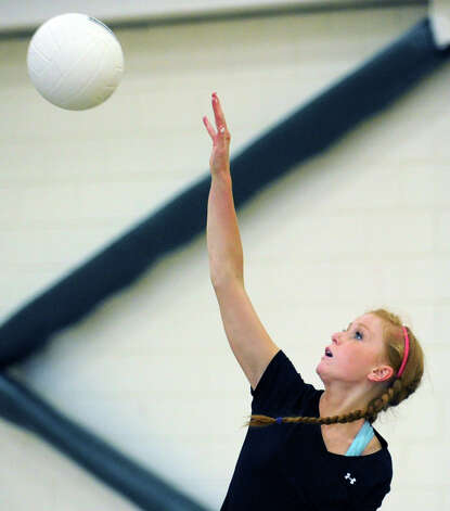 Volleyball captain Taylor Ohman of Greenwich Academy practices serves at the school, Wednesday, Sept. 5, 2012. Photo: Bob Luckey / Greenwich Time