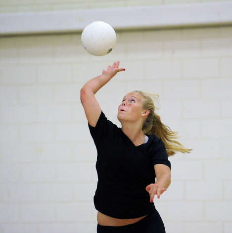 Greenwich Academy's Grace Evans hits prior to volleyball scrimmage against Holy Child at Greenwich Academy, Wednesday, Sept. 5, 2012. Evans is a co-captain of the team. Photo: Bob Luckey / Greenwich Time