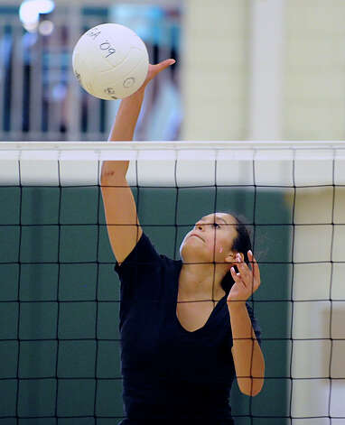 Tyla Taylor of Greenwich Academy spikes a shot prior to volleyball scrimmage against Holy Child at Greenwich Academy, Wednesday, Sept. 5, 2012. Photo: Bob Luckey / Greenwich Time