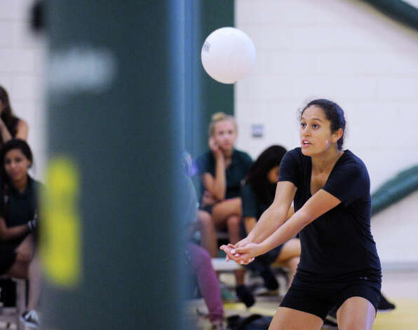 Tyla Taylor of Greenwich Academy returns a shot during volleyball scrimmage against Holy Child at Greenwich Academy, Wednesday, Sept. 5, 2012. Photo: Bob Luckey / Greenwich Time