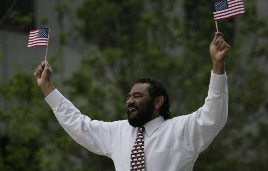 U.S. Congressman Al Green waves to the audience during the Houston Livestock Show and Rodeo parade o