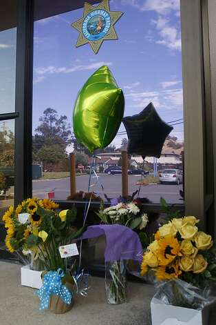 Flowers for officer Kenyon Youngstrom in front of the California Highway Patrol office  in Martinez, Calif., on Wednesday, September 5, 2012. Photo: Liz Hafalia, The Chronicle