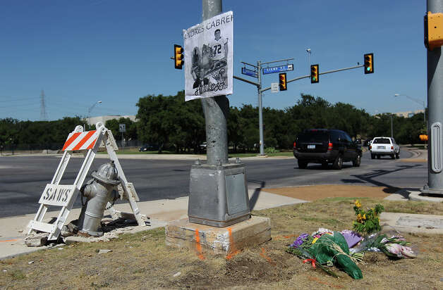 Flowers and a poster memorializing Andres Cabrera Cordero are placed at the intersection of Sonterra and Sigma Roads where the 19-year-old lost his life in an single-car accident on Wednesday, Sept. 5, 2012. Cordero was a 2012 graduate of Reagan High School and driving to San Antonio College when he lost his life after colliding with the utility pole and fire hydrant. Photo: Kin Man Hui, SAN ANTONIO EXPRESS-NEWS / ©2012 San Antonio Express-News