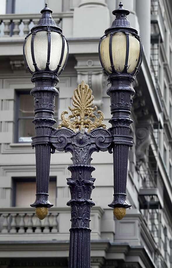 Ornate, historic streetlamps from 1918 that line the sidewalks of San Francisco's Union Square and theater area have fallen into disrepair. Photo: Brant Ward, The Chronicle