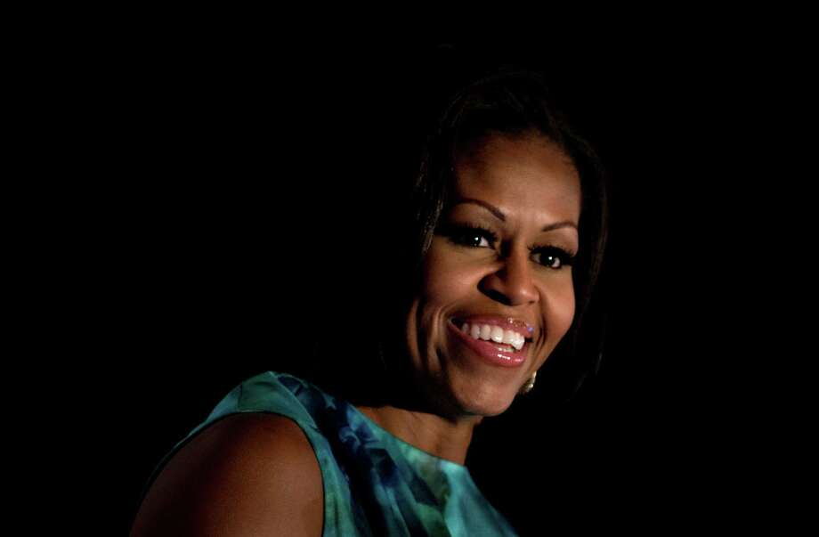 During her convention speech, first lady Michelle Obama talked about the students loans she and the president had to repay. Photo: Brendan Smialowski, Getty Images / 2012 Brendan Smialowski