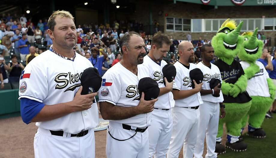 Sugar Land Skeeters pitcher Roger Clemens, left, stands with manager Gary Gaetti, right, as the national anthem is played before the Skeeters' baseball game against the Bridgeport Bluefish Friday, Aug. 24, 2012, in Sugar Land, Texas. Clemens, a seven-time Cy Young winner, signed with the Skeeters of the independent Atlantic League this week and is expected to start for the minor league team Saturday at home against Bridgeport. (AP Photo/David J. Phillip) Photo: David J. Phillip, Associated Press