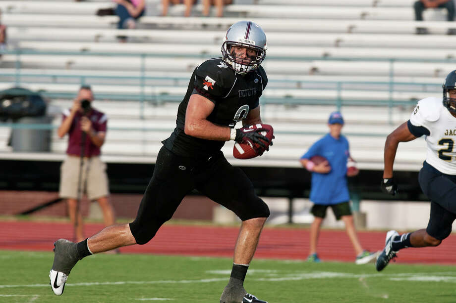 Mason Lytal dashes to the end zone on one of his school-record-tying four TD catches in Trinity's opener.  Courtesy photo / Trinity Athletics Photo: Courtesy Trinity Athletics, Express-News