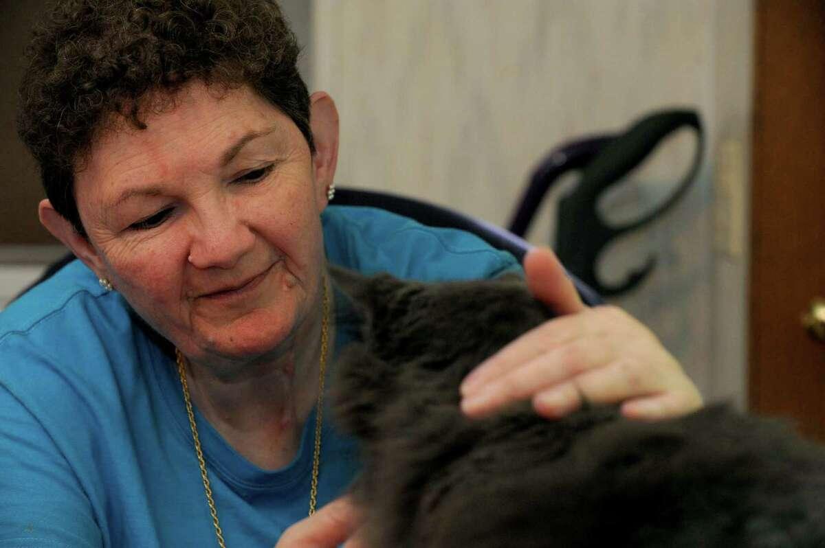 Debbie Van Buren pets her cat Mo in West Berne, NY Wednesday Sept. 5, 2012. (Michael P. Farrell/Times Union)