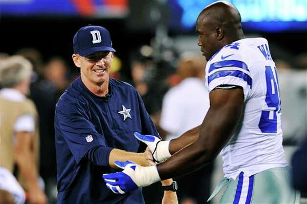 Dallas Cowboys head coach Jason Garrett, left, talks to linebacker DeMarcus Ware before an NFL football game against the New York Giants, Wednesday, Sept. 5, 2012, in East Rutherford, N.J. (AP Photo/Bill Kostroun) Photo: Bill Kostroun, Associated Press / FR59151 AP