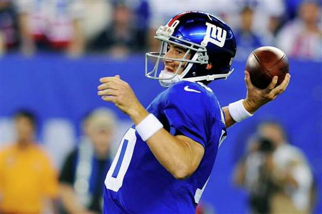 New York Giants quarterback Eli Manning. Bill Kostroun/Associated Press Photo: Bill Kostroun, Associated Press / FR59151 AP