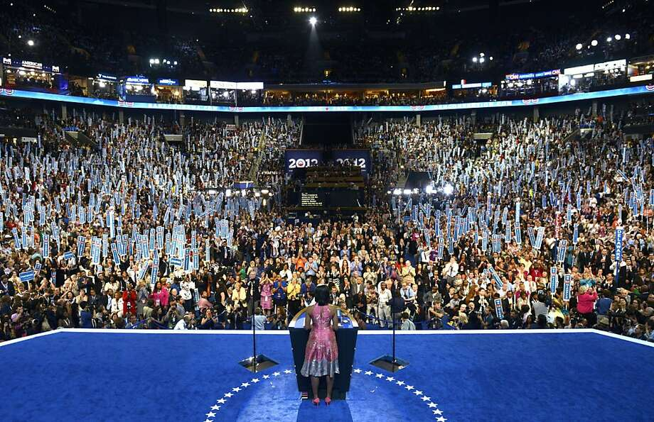 First Lady Michelle Obama delivers a speech at the Time Warner Cable Arena in Charlotte, North Carolina, on September 4, 2012 on the first day of the Democratic National Convention (DNC). Photo: Brendan Smialowski, AFP/Getty Images