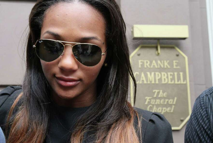 Deja Lighty leaves the Frank E. Campbell Funeral Chapel following the service for her father, hip-ho