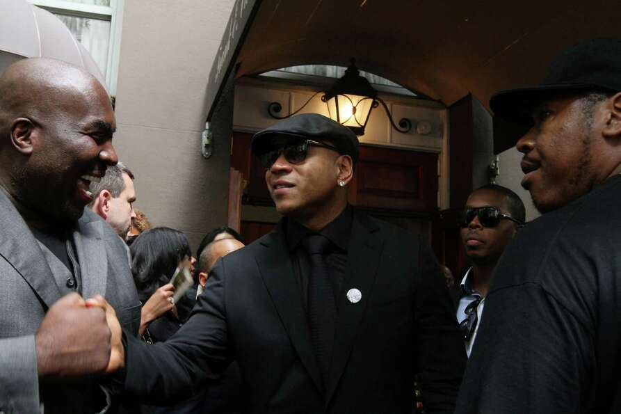 LL Cool J, center, leaves the Frank E. Campbell Funeral Chapel following the service for hip-hop mog