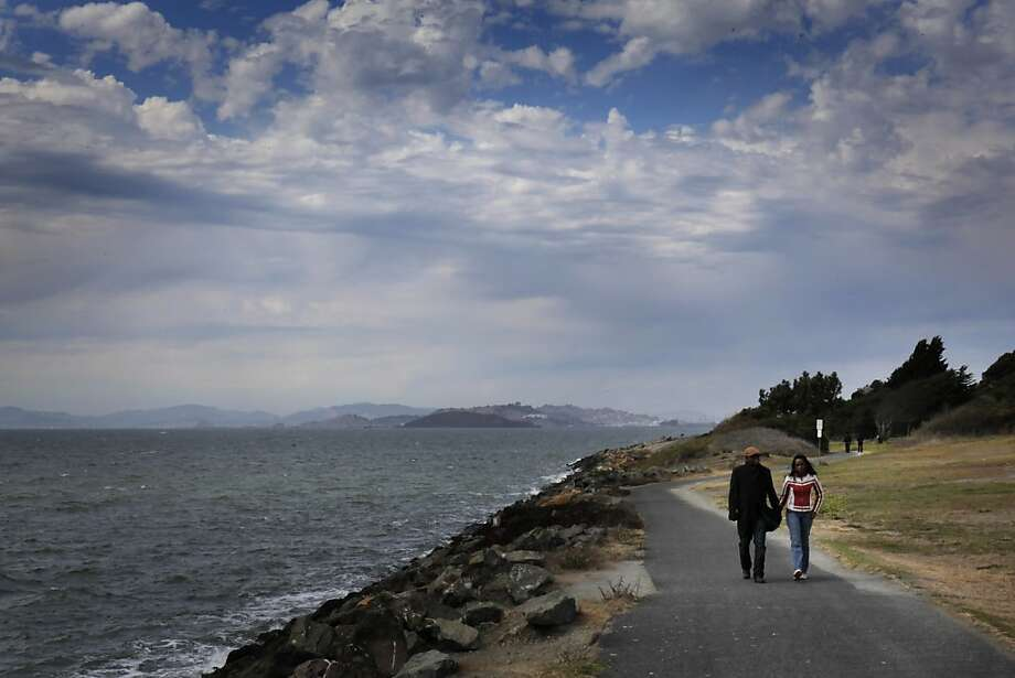 A couple walks by the shore of Cesar Chavez Park at the Berkeley Marina in Berkeley, Calif., on Wednesday, September 5, 2012. The San Francisco Bay Area got its first taste of fall weather on Wednesday, September 5, 2012, as the tail end of tropical storm John hit the area. Photo: Carlos Avila Gonzalez, The Chronicle