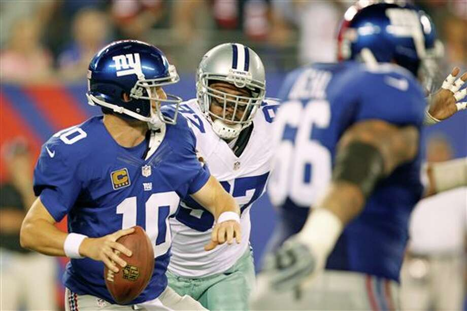 New York Giants' Eli Manning looks to throw during the first half of an NFL football game against the Dallas Cowboys Wednesday, Sept. 5, 2012, in East Rutherford, N.J. (AP Photo/Julio Cortez) Photo: Julio Cortez, Associated Press / AP