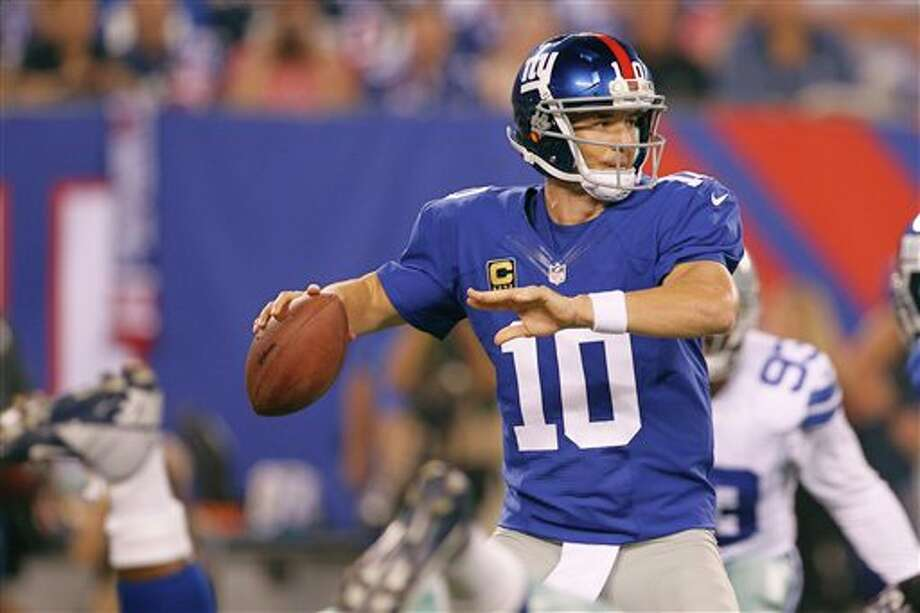 New York Giants' Eli Manning looks to throw during the first half of an NFL football game against the Dallas Cowboys Wednesday, Sept. 5, 2012, in East Rutherford, N.J. (AP Photo/Julio Cortez) Photo: Julio Cortez, Associated Press / AP2012