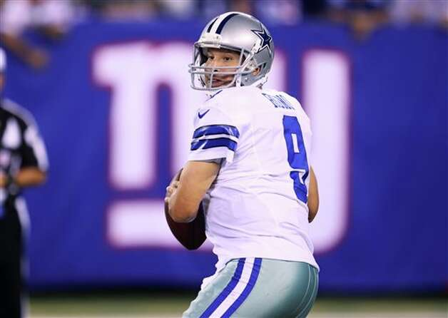 Dallas Cowboys quarterback Tony Romo (9) looks to pass during the first half of an NFL football game against the New York Giants Wednesday, Sept. 5, 2012, in East Rutherford, N.J. (AP Photo/Seth Wenig) Photo: Seth Wenig, Associated Press / AP