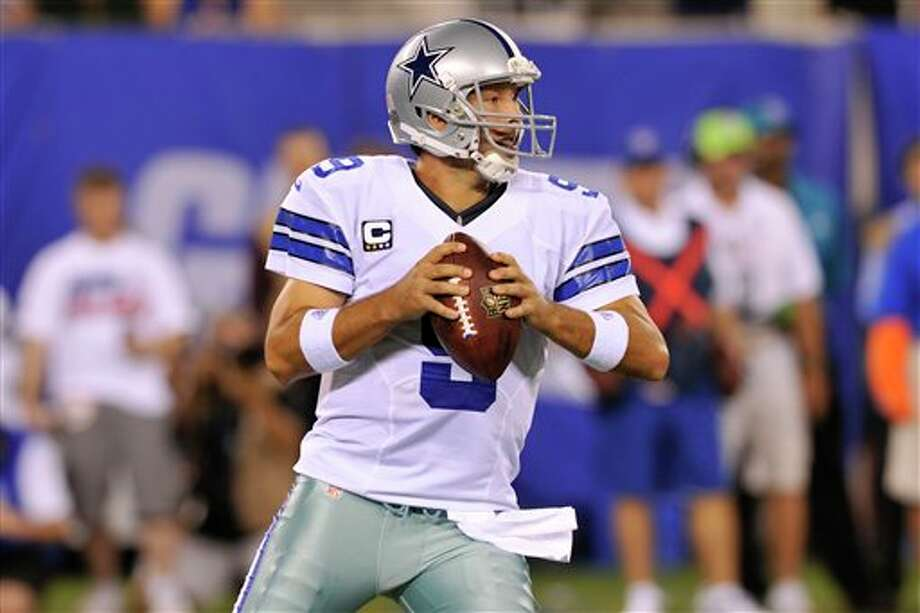 Dallas Cowboys quarterback Tony Romo looks to throw during the first half of an NFL football game against the New York Giants Wednesday, Sept. 5, 2012, in East Rutherford, N.J. (AP Photo/Bill Kostroun) Photo: Bill Kostroun, Associated Press / AP2012