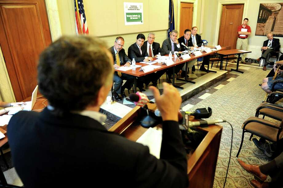Andy Clemente of Bonded Concrete, left, speaks to members of the Assembly about proposed Thruway toll hikes on Wednesday, Sept. 5, 2012, at the Alfred E. Smith Building in Albany, N.Y. (Cindy Schultz / Times Union) Photo: Cindy Schultz /  00019127A