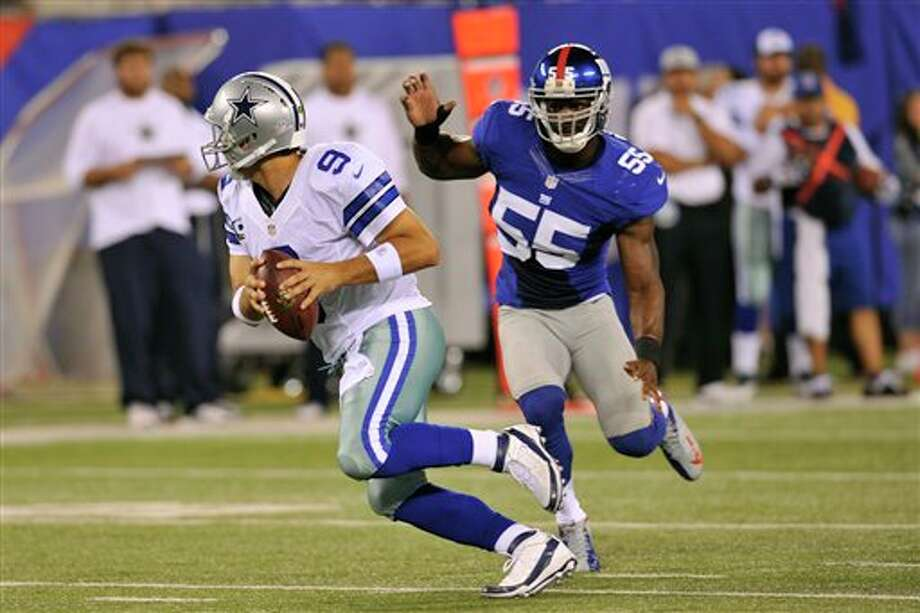 New York Giants linebacker Keith Rivers (55) chases Dallas Cowboys quarterback Tony Romo (9) during the first half of an NFL football game Wednesday, Sept. 5, 2012, in East Rutherford, N.J. (AP Photo/Bill Kostroun) Photo: Bill Kostroun, Associated Press / FR59151 AP