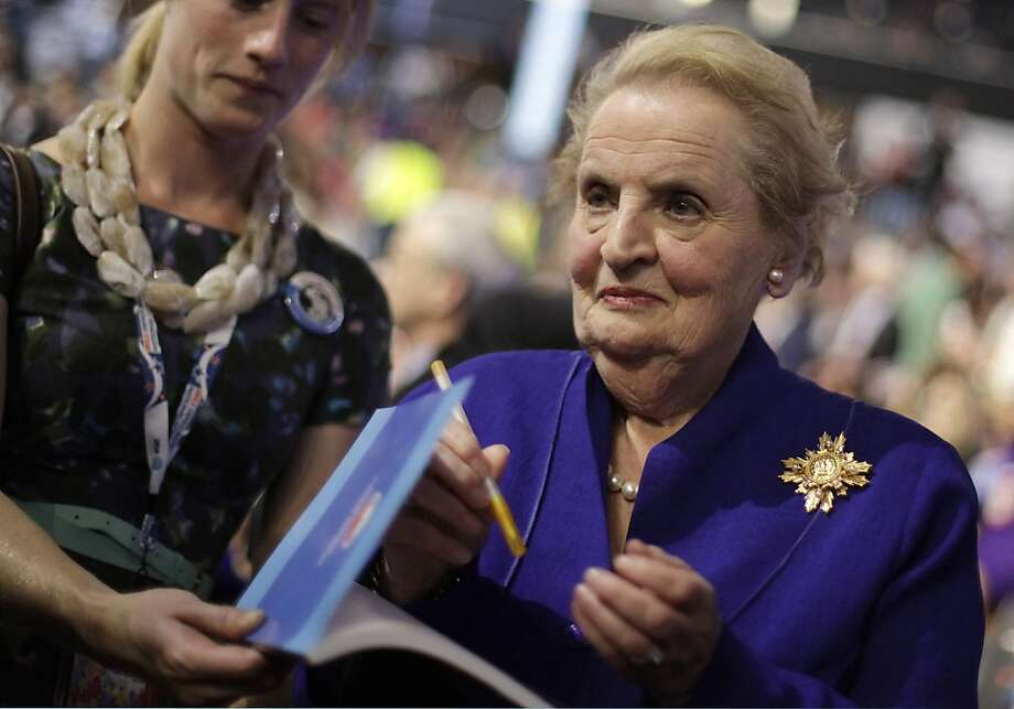 Former Secretary of State Madeleine Albright signs autographs as she arrives at the Democratic National Convention in Charlotte, N.C., on Wednesday, Sept. 5, 2012. Photo: David Goldman, Associated Press