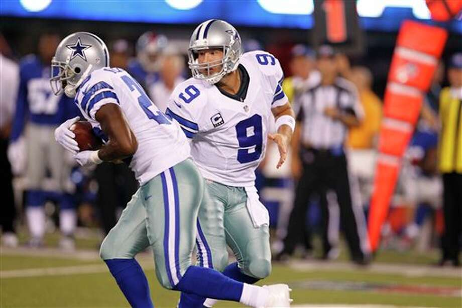 Dallas Cowboys quarterback Tony Romo, right, hands off to  Felix Jones during the first half of an NFL football game against the New York Giants Wednesday, Sept. 5, 2012, in East Rutherford, N.J. (AP Photo/Julio Cortez) Photo: Julio Cortez, Associated Press / AP2012