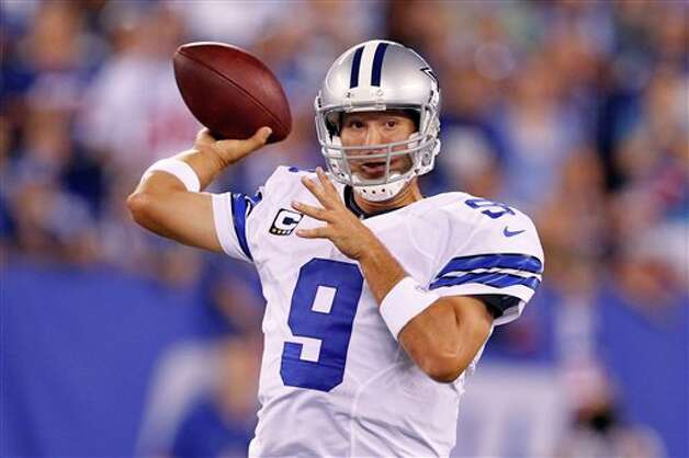 Dallas Cowboys quarterback Tony Romo throws during the first half of an NFL football game against the New York Giants Wednesday, Sept. 5, 2012, in East Rutherford, N.J. (AP Photo/Julio Cortez) Photo: Julio Cortez, Associated Press / AP