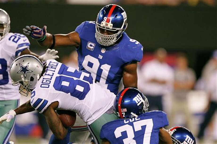 Dallas Cowboys wide receiver Kevin Ogletree (85) carries the ball during the first half of an NFL football game against the New York Giants Wednesday, Sept. 5, 2012, in East Rutherford, N.J. (AP Photo/Julio Cortez) Photo: Julio Cortez, Associated Press / AP