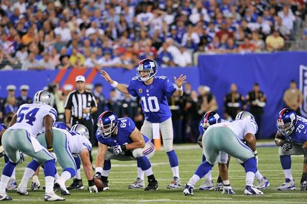 New York Giants quarterback Eli Manning calls a play during the first half of an NFL football game against the Dallas Cowboys Wednesday, Sept. 5, 2012, in East Rutherford, N.J. (AP Photo/Bill Kostroun) Photo: Bill Kostroun, Associated Press / FR59151 AP