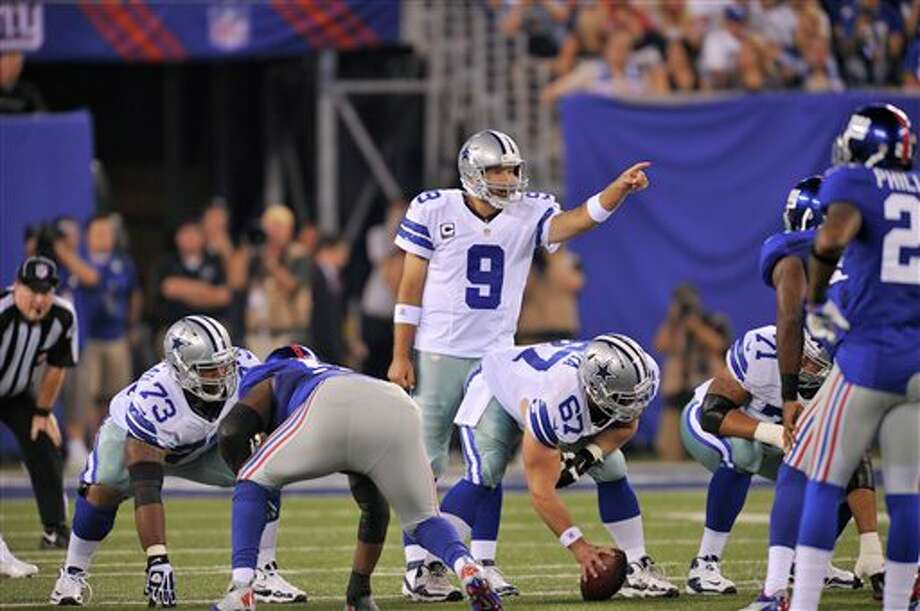 Dallas Cowboys quarterback Tony Romo calls a play during the first half of an NFL football game against the New York Giants Wednesday, Sept. 5, 2012, in East Rutherford, N.J. (AP Photo/Bill Kostroun) Photo: Bill Kostroun, Associated Press / FR59151 AP