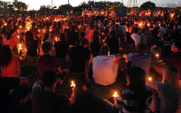 Friends and former classmates of Andres Cabrera gather for a candlelight vigil and remembrance at Reagan High School. Photo: Kin Man Hui, San Antonio Express-News / ©2012 San Antonio Express-News