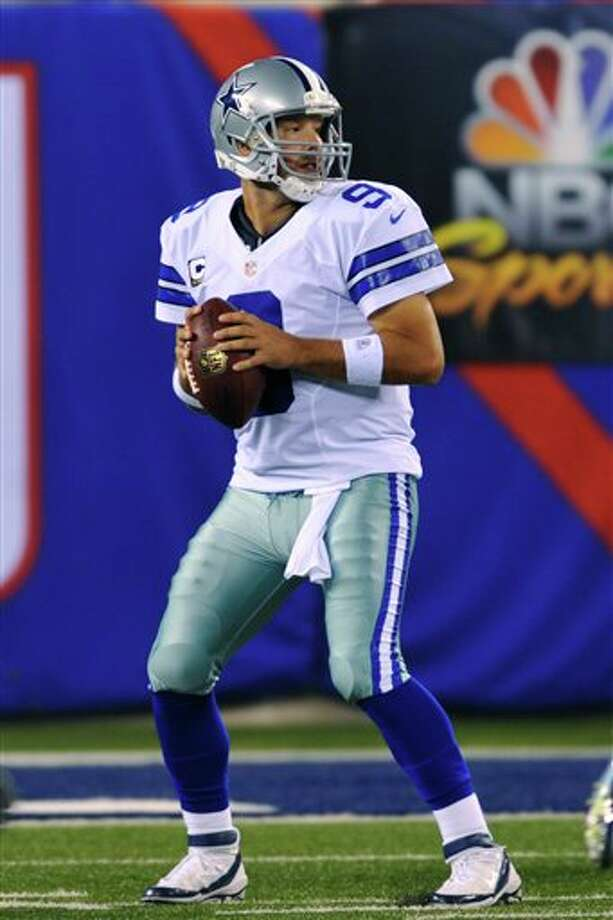 Dallas Cowboys quarterback Tony Romo looks to throw during the first half of an NFL football game against the New York Giants Wednesday, Sept. 5, 2012, in East Rutherford, N.J. (AP Photo/Bill Kostroun) Photo: Bill Kostroun, Associated Press / FR59151 AP