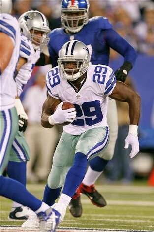 Dallas Cowboys' DeMarco Murray runs with the ball during the first half of an NFL football game against the New York Giants Wednesday, Sept. 5, 2012, in East Rutherford, N.J. (AP Photo/Julio Cortez) Photo: Julio Cortez, Associated Press / AP2012