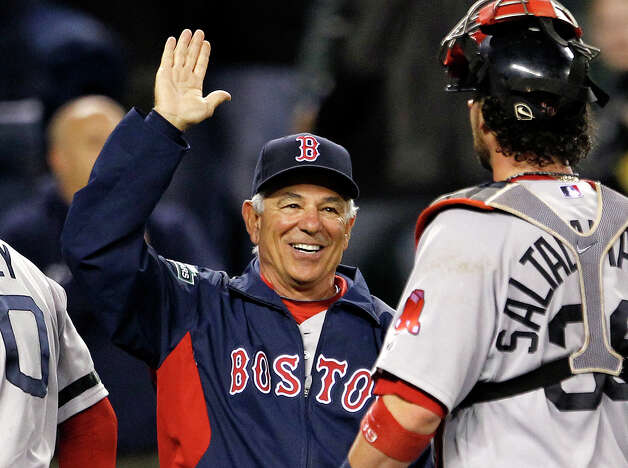 Boston Red Sox manager Bobby Valentine, left, greets catcher Jarrod Saltalamacchia after the team beat the Seattle Mariners in a baseball game Tuesday, Sept. 4, 2012, in Seattle. The Red Sox won 4-3. (AP Photo/Elaine Thompson) Photo: Elaine Thompson, Associated Press / AP