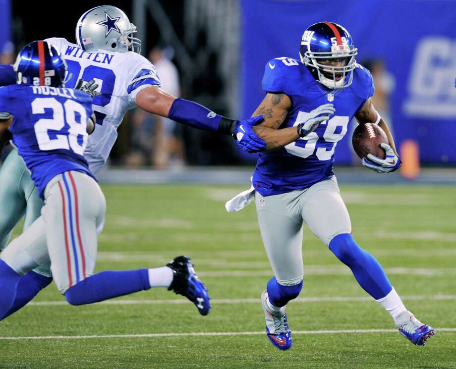 New York Giants linebacker Michael Boley was stopped just short of the end zone after picking off Tony Romo. Photo: Bill Kostroun, Associated Press / FR59151 AP