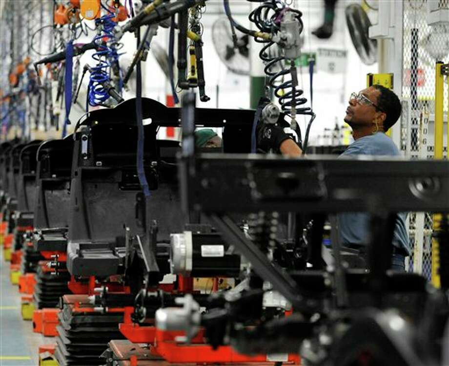 In this Thursday, July 19, 2012, photo, assembler Barry Austin works on a golf car production line at the E-Z-GO plant in Augusta, Ga. U.S. factory activity shrank for the third straight month in August as new orders, production and employment all fell. The report adds to other signs that manufacturing is struggling around the globe. (AP Photo/Rainier Ehrhardt) Photo: Rainier Ehrhardt, AP / FR155191 AP