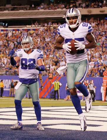 The Dallas Cowboys' Kevin Ogletree, right, celebrates his 10-yard touchdown catch in the second quarter with Jason Witten (82) in the NFL season opener against the New York Giants at MetLife Stadium in East Rutherford, New Jersey, on Wednesday September 5, 2012. (Ron T. Ennis/Fort Worth Star-Telegram/MCT) Photo: Ron T. Ennis, McClatchy-Tribune News Service / Fort Worth Star-Telegram