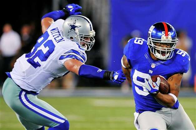 New York Giants linebacker Michael Boley (59) runs back an interception past Dallas Cowboys tight end Jason Witten (82) during the first half of an NFL football game, Wednesday, Sept. 5, 2012, in East Rutherford, N.J. (AP Photo/Bill Kostroun) Photo: Bill Kostroun, Associated Press / FR59151 AP