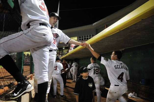 Lance Day, left, extends his fist to Tri-City ValleyCats teammate, Joe Sclafani, right, during the ninth inning, Wednesday night Sep. 5, 2012, at Joseph L. Bruno Stadium in Troy, N.Y. ValleyCats lost 3-2 to the Hudson Valley Renegades. (Will Waldron / Times Union) Photo: Will Waldron