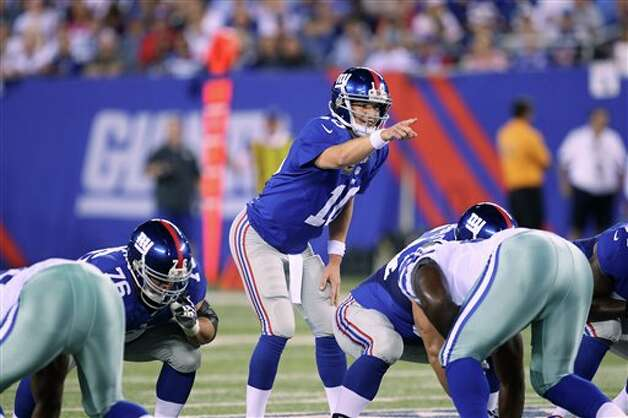 New York Giants' Eli Manning calls a play during the first half of an NFL football game against the Dallas Cowboys Wednesday, Sept. 5, 2012, in East Rutherford, N.J. (AP Photo/Seth Wenig) Photo: Seth Wenig, Associated Press / AP