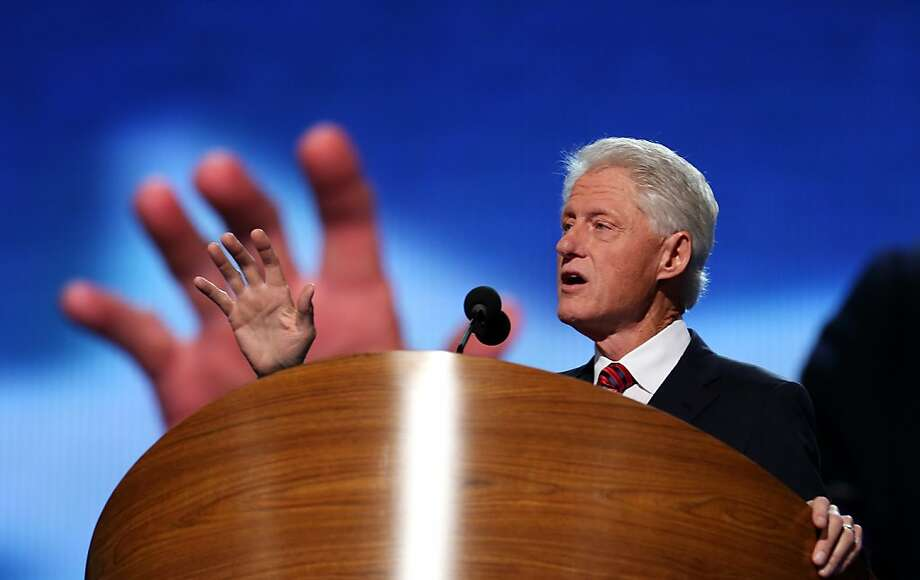 Former President Bill Clinton tries to lend President Obama's campaign a hand during his speech at the Democratic National Convention. Photo: Chip Somodevilla, Getty Images