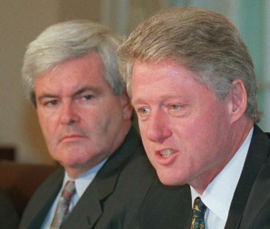 FILE - In this July 29, 1996, file photo, House Speaker Newt Gingrich listens as President Clinton talks to reporters in the Cabinet Room of the White House prior to a meeting to discuss terrorism. To hear Republican presidential contender Gingrich tell it, he and Clinton were political partners in the 1990s, lowering unemployment, balancing the federal budget and keeping the nation's economy in robust health. In fact, the economy wasn't as rosy as he's claiming during his time in leadership. And the Clinton-Gingrich relationship was marked by intense cycles of warfare and courtship. (JOE MARQUETTE / Associated Press)