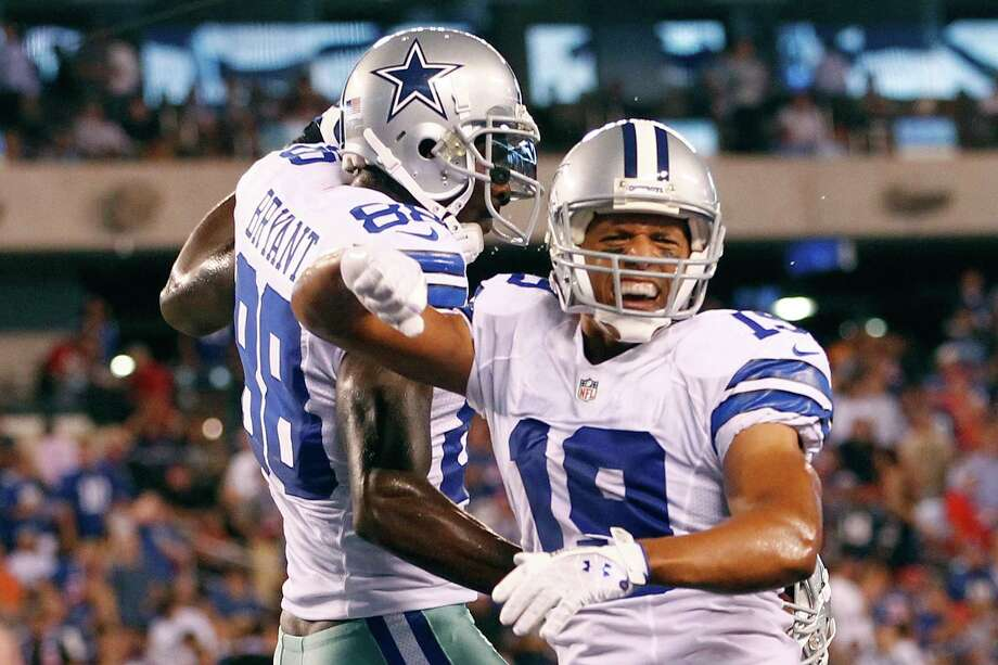 EAST RUTHERFORD, NJ - SEPTEMBER 05:  wide receiver Miles Austin #19 of the Dallas Cowboys celebrates after scoring a touchdown in the fourth quarter with teammate wide receiver Dez Bryant #88 against the New York Giants during the 2012 NFL season opener at MetLife Stadium on September 5, 2012 in East Rutherford, New Jersey. Photo: Jeff Zelevansky, Getty Images / 2012 Getty Images