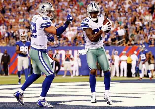 EAST RUTHERFORD, NJ - SEPTEMBER 05:  wide receiver Kevin Ogletree #85 of the Dallas Cowboys celebrates with teammate tight end Jason Witten #82 after scoring a touchdown in the second quarter against the New York Giants during the 2012 NFL season opener at MetLife Stadium on September 5, 2012 in East Rutherford, New Jersey. Photo: Jeff Zelevansky, Getty Images / 2012 Getty Images