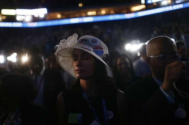 A delegate closes her eyes while listening to Former U.S. President Bill Clinton, unseen, speak during day two of the Democratic National Convention (DNC) in Charlotte, North Carolina, U.S., on Wednesday, Sept. 5, 2012. Democratic officials have moved President Barack Obama's nomination acceptance speech tomorrow night to the Time Warner Cable Arena from the larger, outdoor Bank of America Stadium because of the possibility of severe weather. Photographer: Victor J. Blue/Bloomberg Photo: Victor J. Blue, Bloomberg