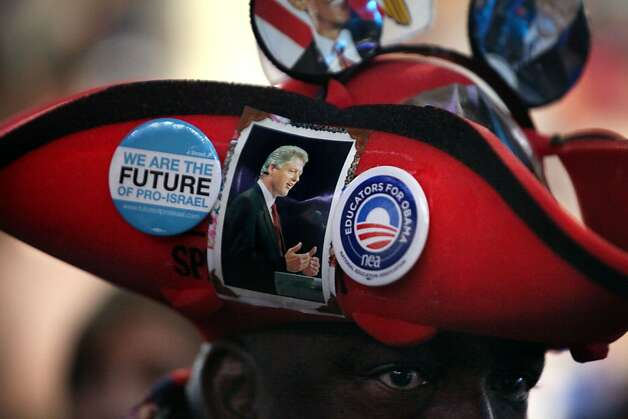 "Edgar ""Baker"" Phillips, of the U.S. Virgin Islands, wears a hat he made with a nod to Bill Clinton at the Time Warner Arena during the Democratic National Convention in Charlotte, N.C., on Wednesday, Sept. 5, 2012. Phillips said he is a logistics coordinator for the office of the governor of the Virgin Islands. He said he loves President Clinton because according to Phillips, Clinton visited the Islands three times during his presidency. He said he was involved with the logistics of one of Clinton's trips and he was able to meet him. (AP Photo/The Tampa Bay Times, Kathleen Flynn) TAMPA OUT; CITRUS COUNTY OUT; PORT CHARLOTTE OUT; BROOKSVILLE HERNANDO OUT; USA TODAY OUT; MAGS OUT Photo: Kathleen Flynn, Associated Press"
